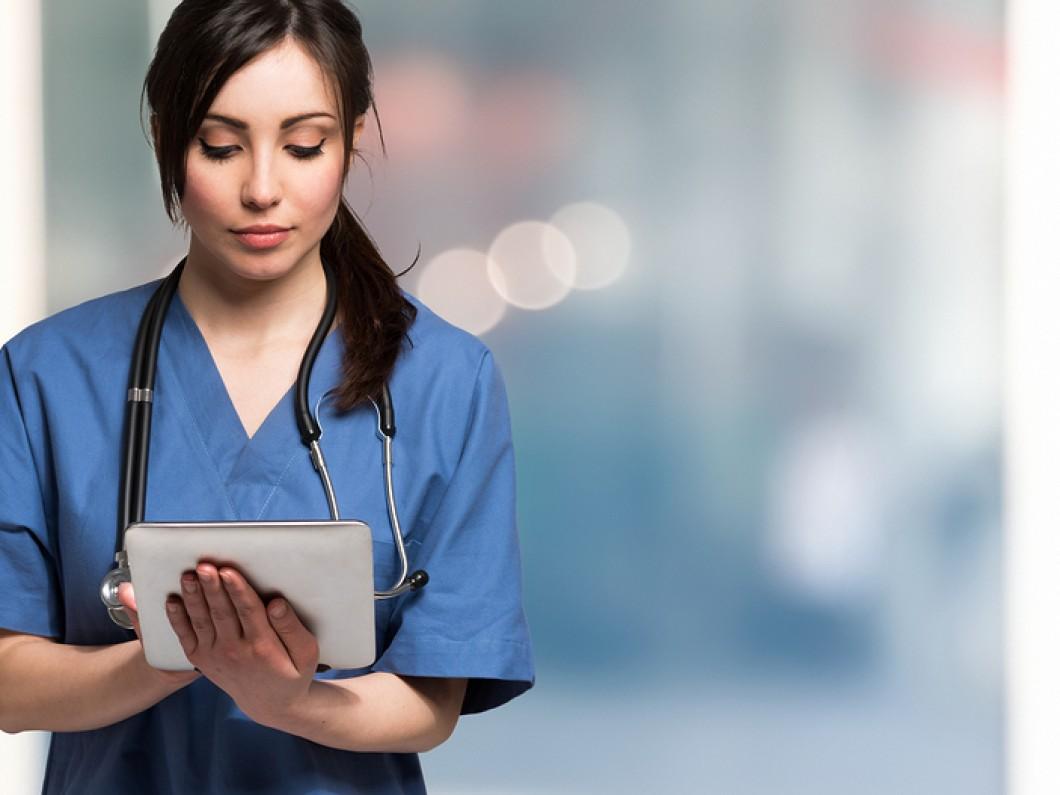 Portrait-of-a-nurse-using-a-di-101730137