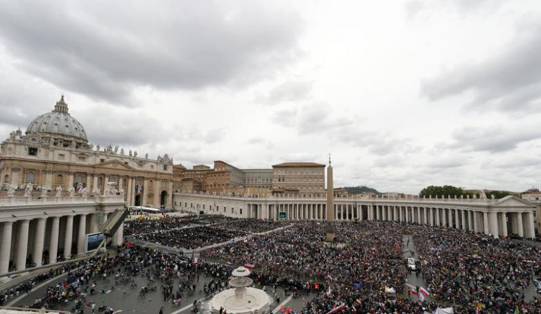 Pope Francis greets the faithful as he rides in his Popemobile after the canonisation ceremony of Popes John XXIII and John Paul II in St Peter's Square at the Vatican