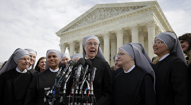 Sister Loraine McGuire with Little Sisters of the Poor speaks to the media after Zubik v. Burwell was heard by the U.S. Supreme Court in Washington